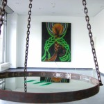 InstallationOil on canvas, metal frame lacquered glossy black, 240cm x 180cm. Green light installed behind painting casts a green aura on the wall behind the painting. Object - heavy metal round frame, 70cm, hanging from ceiling by 3 metal chains. Inside the frame sits a mirror containing 3 lines of bright green powder. The installation is lit from above with.